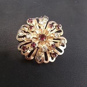 Flower broach with red and white stone